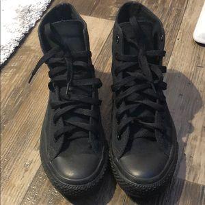 High top all black converse.